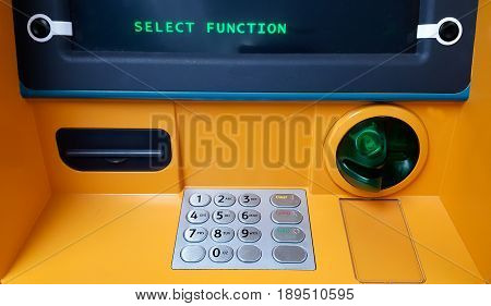 Portrait of a hand typing a PIN code at an ATM