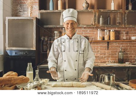 Bakery chef cooking bake in the kitchen professional making roll