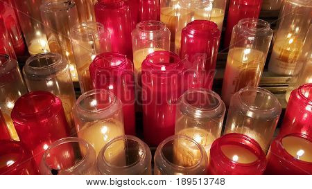 Burning candles in glass candlesticks in the Catholic Church