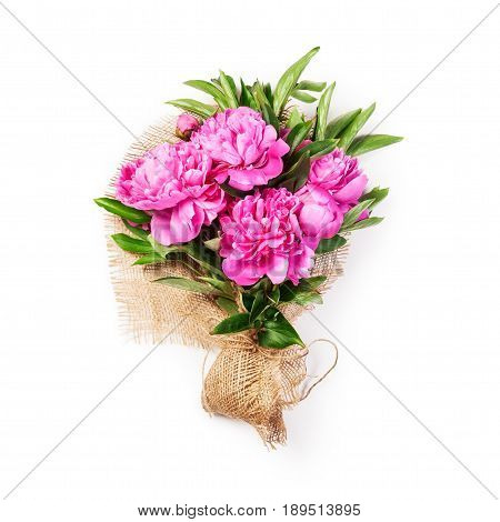 Pink peony flowers bouquet with jute burlap fabric. Single object isolated on white background. Flower arrangement