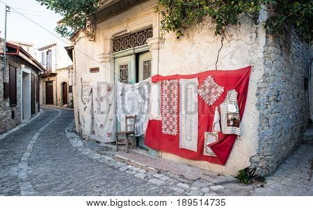 Lefkara Cyprus - August 21 2016: Handmade lace called lefkaritika hanging on the wall of a house at Lefkara village Larnaca district Cyprus