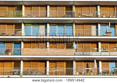 Facade with balconies of a modern orange apartment building