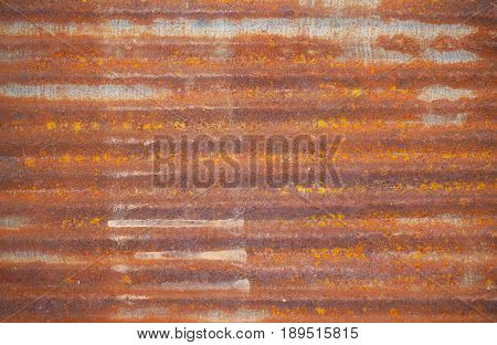 Old brown zinc. The fence in the country house has long been used as a rusty scratch and cracks. can be used as vintage background concept.