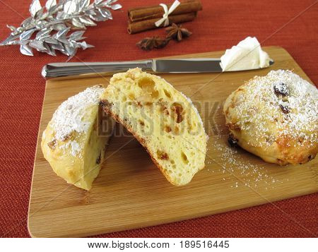 Homemad stollen scones with clotted cream on cutting board