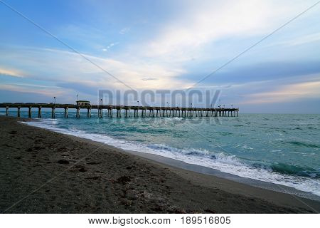 The pier behind Sharkys Restaurant in Venice Florida jetting out into the Gulf of Mexico for all to enjoy.
