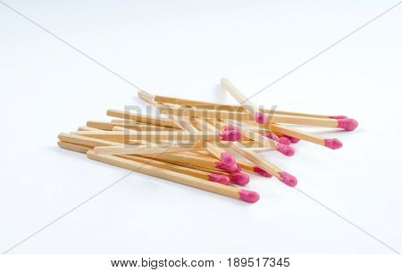 Pile of big matches with rose match head isolated on white background