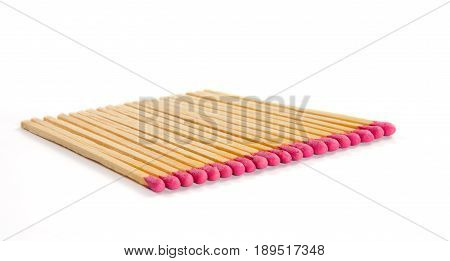 Row of matches with rose match heads isolated on white background