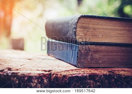 Ancient book on a wooden table , literacy and knowledge concept