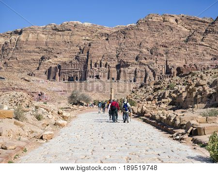Petra Jordan - 9 March 2017: Tourists walking on the colonnaded street in Petra Jordan 9 March 2017