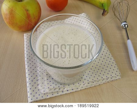 Glass of pur kefir and fruits on table