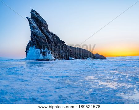 View of Ogoy Island in Frozen Lake Baikal, Russia, at dawn