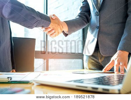 Businessmen shake hands after agreeing,Business success concept.
