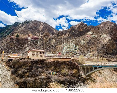 View of tibetan buddhist monastery at the mountain in Sichuan China