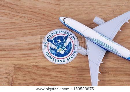 SARANSK, RUSSIA - MAY 24, 2017: United States Department of Homeland Security seal with airplane model.