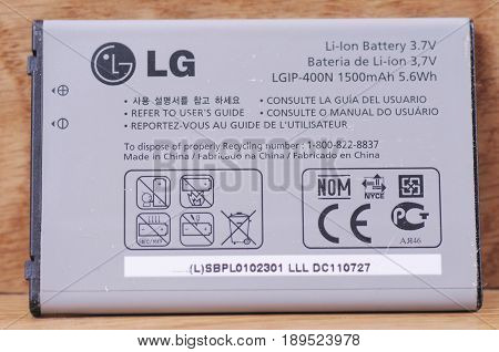 SARANSK, RUSSIA - MAY 28, 2017: LG lithium-ion battery on wooden background.