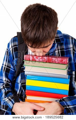 Sad and Tired Teenager with the Books Isolated on the White Background