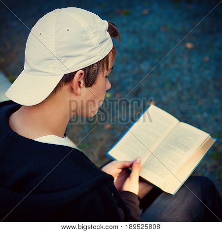 Toned Photo of Teenager with a Books on the Street