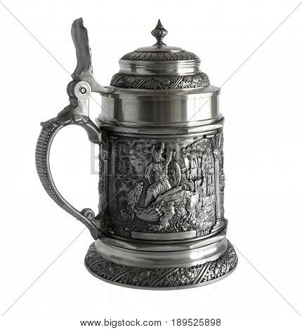 Pewter beer tankard with relief The Song of the Nibelungs isolated on a white background