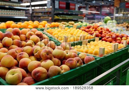 Shelf with fruits in large food supermarket