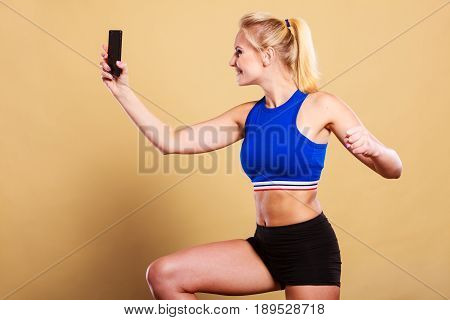 Fit Woman Taking Selfie Picture With Phone