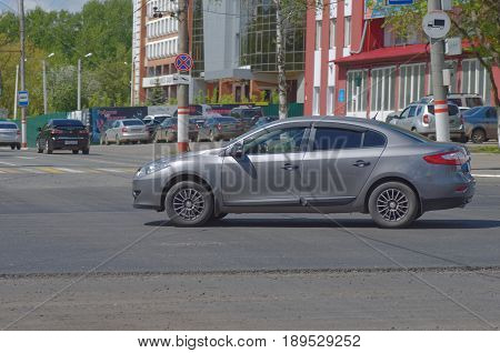 SARANSK, RUSSIA - MAY 20, 2017: Grey Renault Fluence on crossroads.
