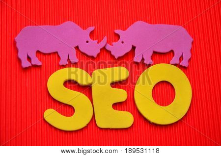 word seo on a  abstract red background