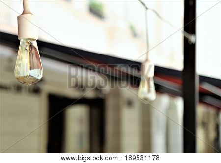 Designer light bulbs with the background of fancy caffee