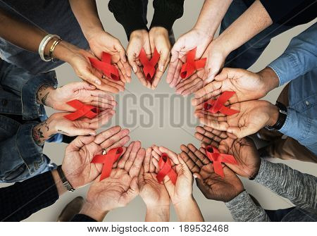 Group of hands holding red ribbon stop drugs and HIV/AIDS awareness