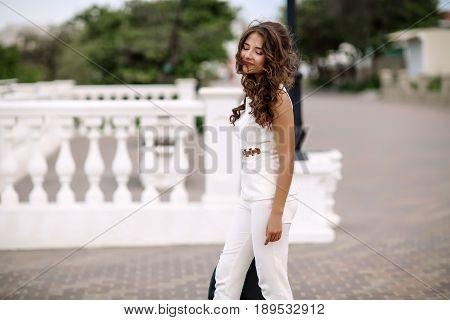 Beautiful Stylish Brunette Girl, Street Portrait, Street Fashionable Look. Beautiful Woman With Long