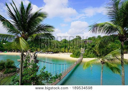 Sunny Palawan Beach and Southernmost point of continental Asia bridge of Sentosa Island in Singapore.