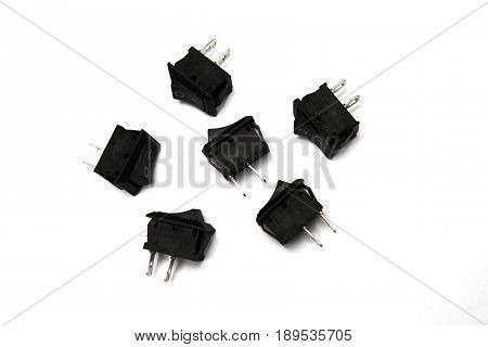 Top view of five plug adapters on the desk isolated on white background