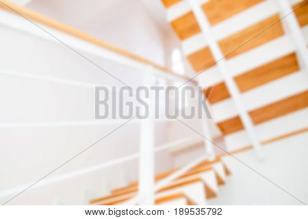 Blur image of the modern wooden stair way in home close up.