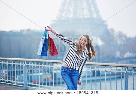 Girl With Shopping Bags Near The Eiffel Tower