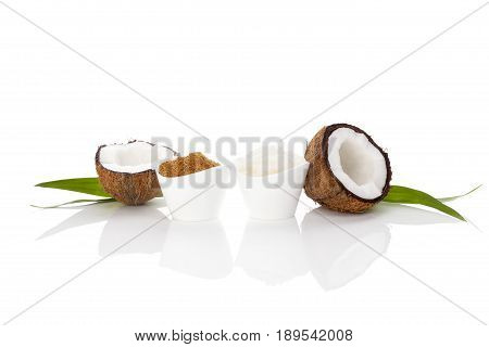 Coconut sugar and hard coconut oil isolated white background. Coconut concept.