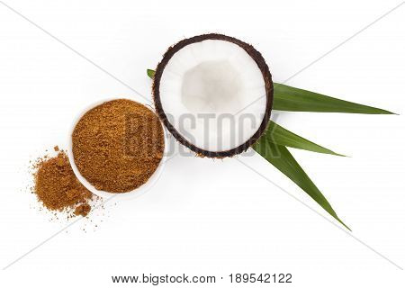 coconut half with powder from above isolated on white background