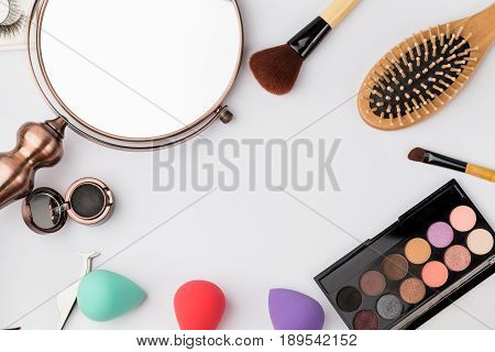 top view vintage metal mirror and make up set collection.