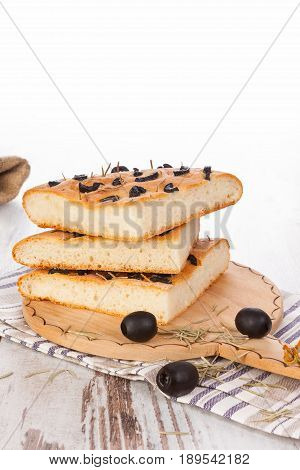Focaccia bread with olives. Traditional italian bread.
