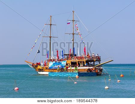Gelendzhik Russia - July 30 2016 - Feast of Neptune Day costume show on a ship with a floating stage on the waves of the black sea