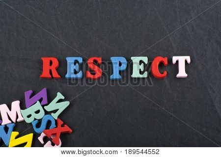 RESPECT word on black board background composed from colorful abc alphabet block wooden letters, copy space for ad text. Learning english concept