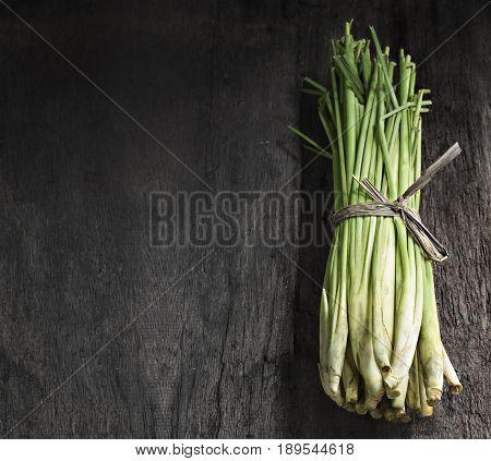 Bundle of Lemon Grass on wood background.