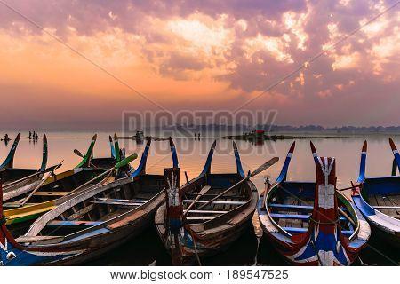 Local Boats and U Bein bridge at Taungthaman Lake in Mandalay Myanmar.