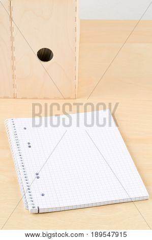 Brown wooden office desk with empty notepad and folders - study or workplace background mock up
