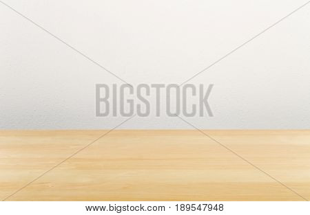 Brown wooden empty office desk with white wall - copy space