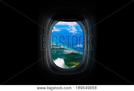 Costline, sea and sky from the airplane's Porthole. Dominican Republic