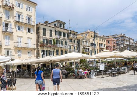 KERKYRA, GREECE - MAY 23: Residents and tourists on the old colorful street on May 23, 2017 in Kerkyra, Corfu island in Greece.