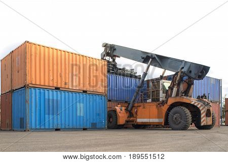 Forklift handling container box loading at port cargo white background