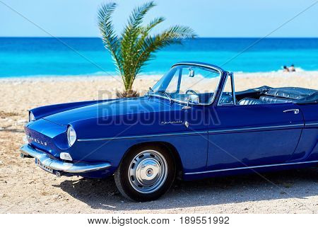 Villajoyosa Spain - May 28 2017: Renault Caravelle or Renault Floride car on the tropical beach. It is a sports car which was produced by the French manufacturer Renault between 1958 and 1968