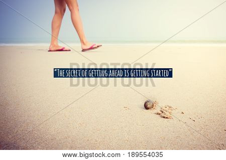 Inspirational quote on girl feet walking on sand back behind hermit crab walking forward show emotional moment.