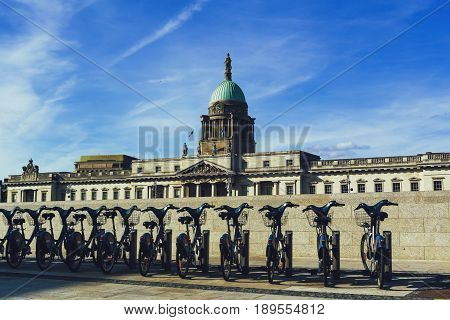 View Of The Customs House In Dublin And City Bikes From Across The River Liffey