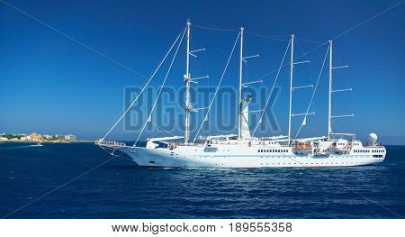 RODOS ISLAND, GREECE, JUNE 25, 2013: View on beautiful classic white yacht WIND SPIRIT Nassau with tourists. Greek island holidays. Greece tours for island holidays on blue sea